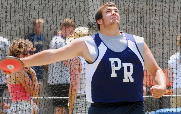Poland High School's Tony Benedict prepares to release a discus at the 2014 Class B Track and Field Championship Meet at the Brewer Community Track on Saturday.