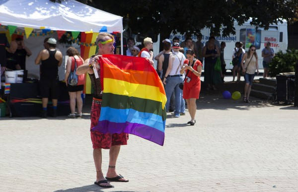 Randy Beal enjoys the Bangor Pride Festival on Saturday at Pickering Square in Bangor.