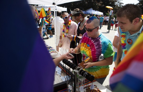 Suzanne Gibson (second from right) buys pride merchandise during the Bangor Pride Festival.
