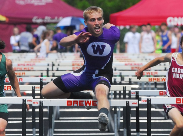 Waterville's Troy Gurski finishes the trial heat of the 110-meter hurdles with a time of 15:5 at the 2014 Class B Track and Field Championship Meet at the Brewer Community Track on Saturday.