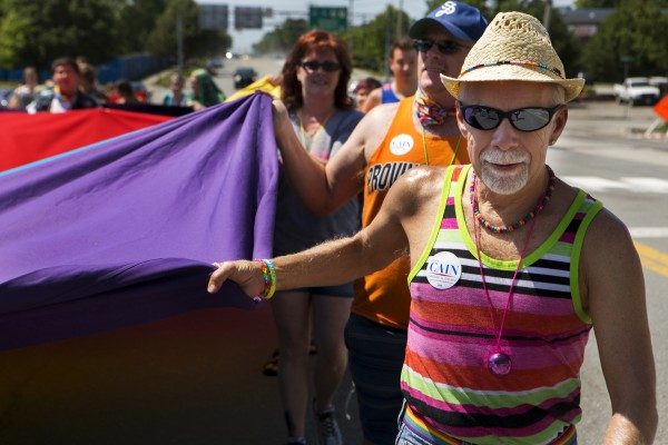 Dick Perry (front) helps carry a large pride flag in the parade during the Bangor Pride Festival on Saturday.