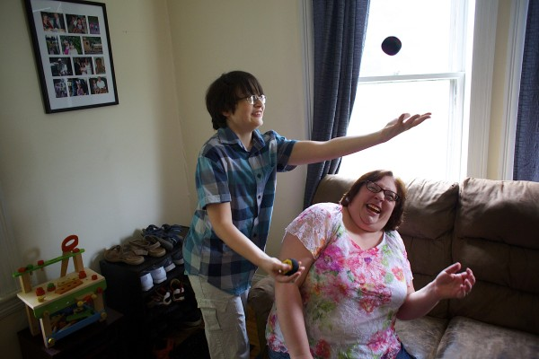 Jacob Lewis juggles in front of his mother, Amanda Morin, at his home in Bangor.