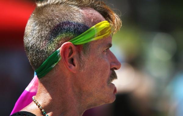 Randy Beal enjoys the Bangor Pride Festival on Saturday at Pickering Square in Bangor.