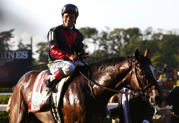 Jockey Joel Rosario, in the irons on Tonalist, smiles after winning the 146th running of the Belmont Stakes at Belmont Park in Elmont, New York, on June 7, 2014.