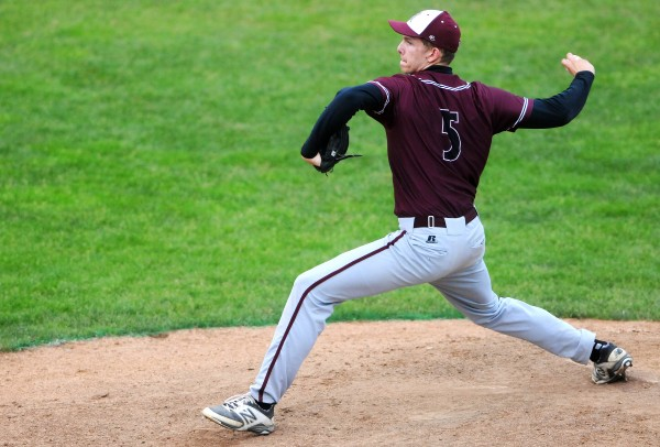 Washington Academy's Gage Feeney pitches to George Stevens Academy during their Eastern Maine Class C baseball final at Mansfield Stadium Tuesday. Washington Academy won 3-0.