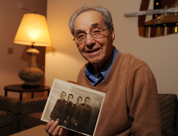 Lester Cohen of Bangor holds a picture of himself (second from right) with his three brothers (from left), Sam, Bernard and George, in uniform during World War II.