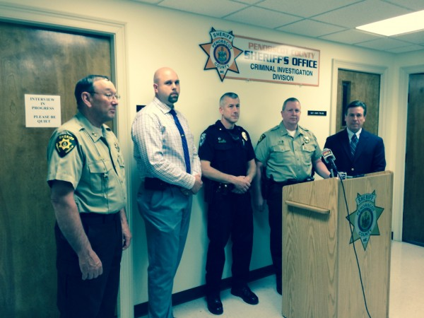 Penobscot County Sheriff Glenn Ross (left), Orono police Detective Sgt. Derek Dinsmore, Orono Chief Josh Ewing, Penobscot County Deputy Chief Troy Morton and Detective Robert Jordan talk about how law enforcement collaboration led to Thursday's arrest of Troy Gay, 26, of Old Town for two recent bank robberies.