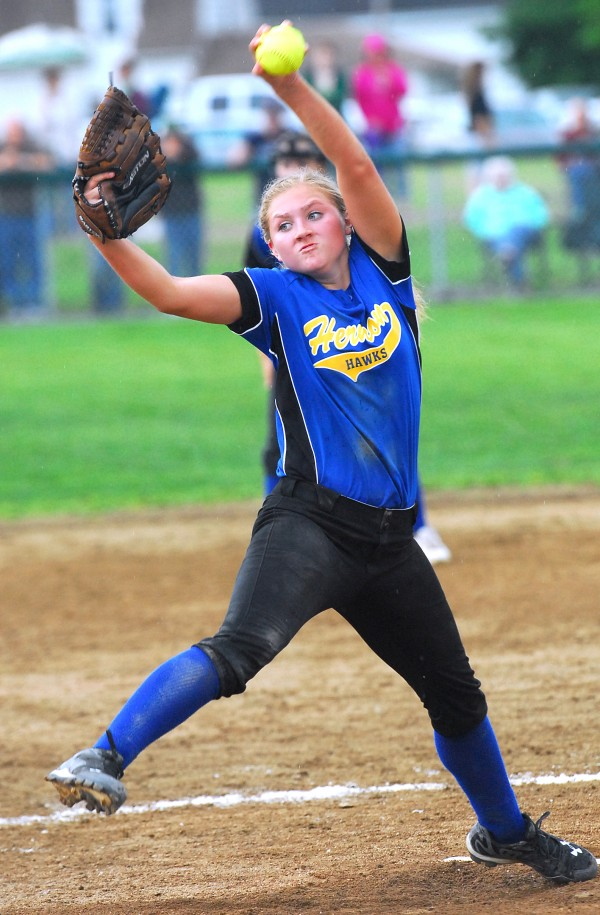 Hermon High School pitcher Karli Theberge delivers a pitch during the seventh inning of the Eastern Maine Class B semifinal softball game Saturday afternoon in Old Town.