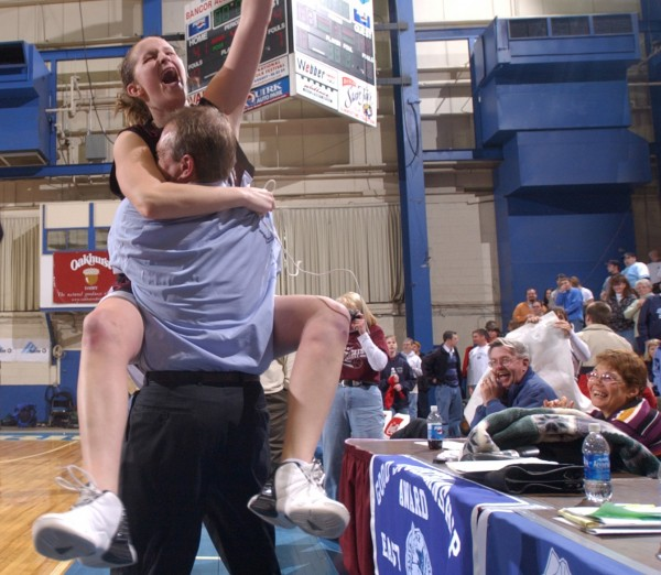 Nokomis' Danielle Clark gives coach Earl Anderson a hug during the awards ceremony after Nokomis defeated Cony to win the Eastern Maine Class A title at the Bangor Auditorium in this 2003 file photo.