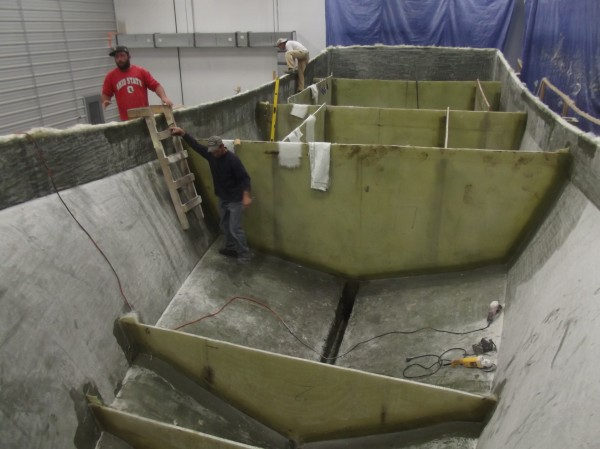 Workers at Millennium Marine are busy building one of several boats under construction at the company's new shop in Eastport. The company has 12 employees and expects to add more soon.