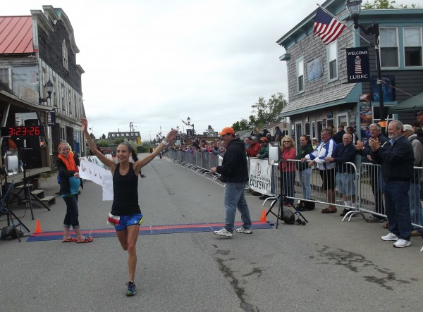 Lydia Kouletsis of Oakland celebrates after being the first woman to cross the finish line in the Bay of Fundy International Marathon. Kouletsis, 22, was running her first marathon. She led women runners with her time of 3 hours, 24 minutes, .03 seconds.