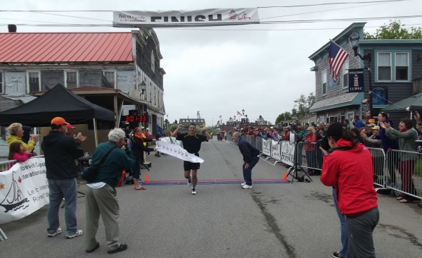 Ron Peck of Waterville crosses the finish line to win the Bay of Fundy International Marathon. Peck, a biology professor at Colby College, was the overall top finisher in the second annual event with a time of 3 hours, 2 minutes, 10 seconds.