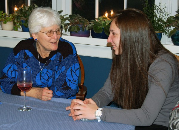 Jane Brann (left), a member of the Friends of Maine Women's Basketball booster organization, chats with Black Bear player Milica Mitrovic during one of the group's fund-raising events.