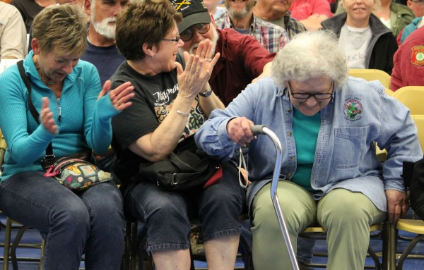 Ina H. Cyr (right), 82, of Presque Isle accepts congratulations of her daughter Irene Murphy (left) and friend Rory Collings after her name was drawn as a winner of a Maine moose permit during the permit lottery at the University of Maine at Presque Isle on Saturday.