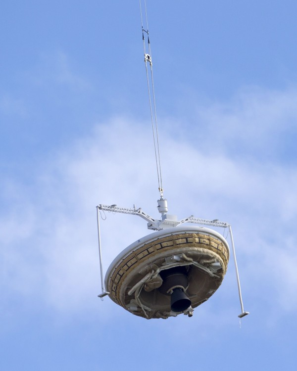 A saucer-shaped test vehicle, which holds equipment for landing large payloads on Mars, is lifted up by a high altitude balloon at the Navy's Pacific Missile Range Facility in Kauai, Hawaii.