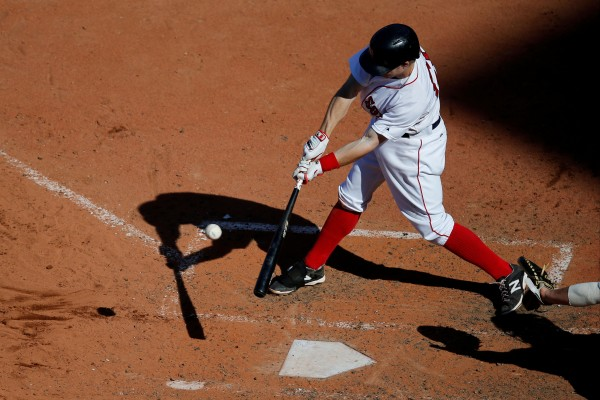Boston's Brock Holt hits a double during the eighth inning against the Tampa Bay Rays at Fenway Park in Boston Sunday. The Red Sox won 4-0.