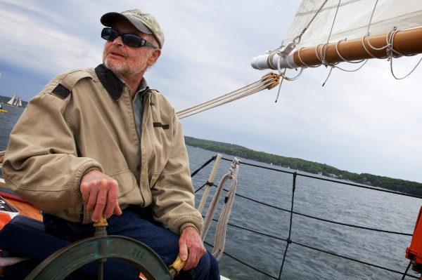 Herb Smith sits at the helm of the schooner Eastwind in Boothbay Harbor on Wednesday. He built the schooner -- his sixth -- and launched it in Belfast in 1999.