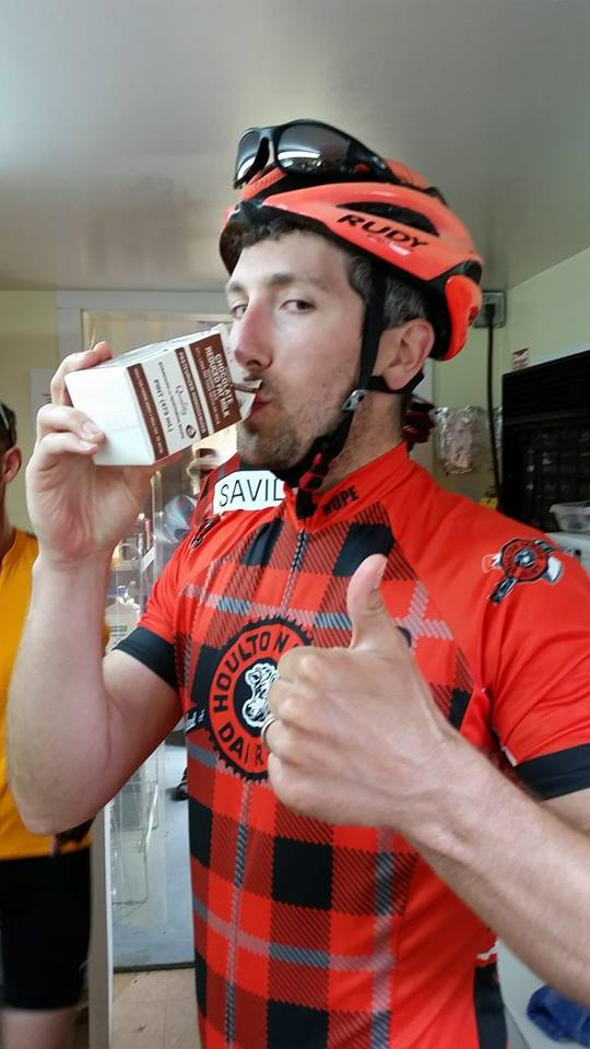 Team Houlton Farms Dairy rider Brian Hupe refuels with some Houlton Farms Dairy chocolate milk on a recent ride in Aroostook County. When it comes to proper post-exercise recovery, there is plenty of good science that says chocolate milk is not only tasty, but has a near perfect ratio of carbohydrates to protein.