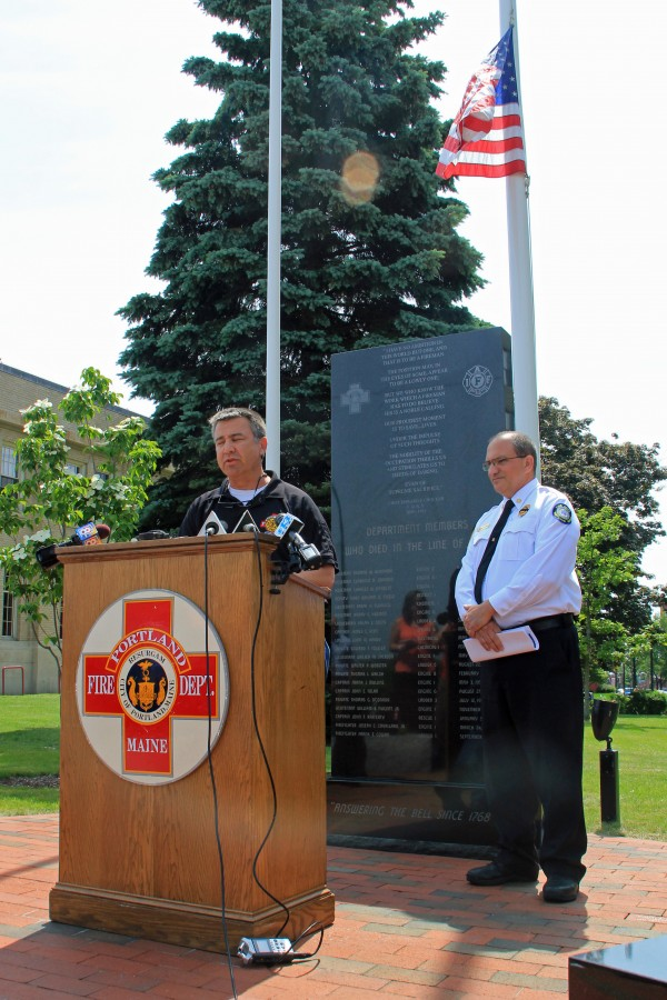 John Brooks, president of the Portland Firefighters Union Local 740, mourned the off-duty death of his colleague Michael Kucsma during a diving accident near Tukey's Bridge in Portland. Portland Fire Department Chief Jerry LaMoria, right, said an investigation into the cause of the accident is still underway.