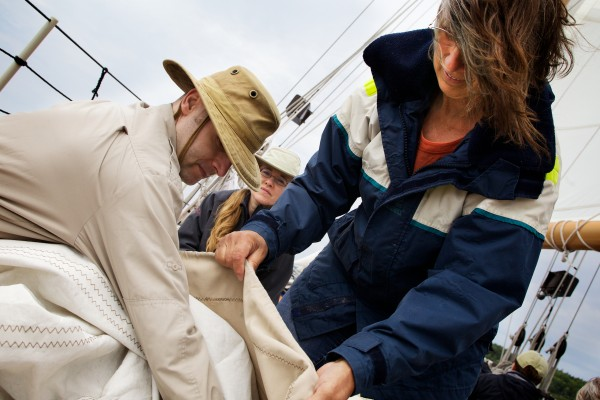 Tom (from left) Jennifer and Doris Smith stow a topsail aboard the schooner Eastwind on Wednesday in Boothbay Harbor.