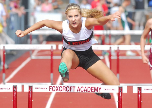 Chase Collier of Lisbon clears the final hurdle for second place during the 300 meter hurdles at the Class C State Track and Field Championship meet at Foxcroft Academy Saturday.