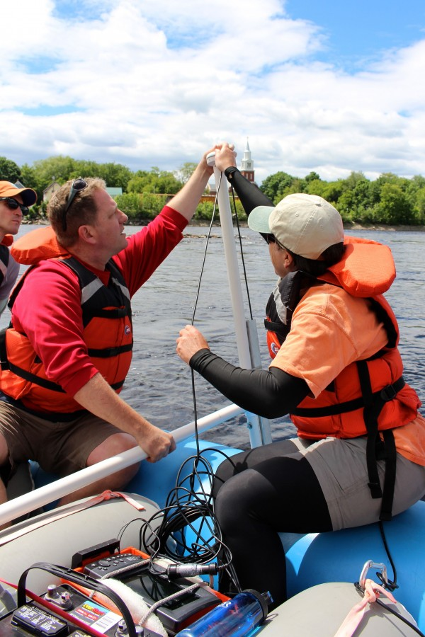 Sean Smith (left), assistant professor at the UMaine School of Earth and Climate Sciences, and Gayle Zydlewski, associate professor at the UMaine School of Marine Science, set up a device on Friday to map the bottom of the Penobscot River with sonar and photos.