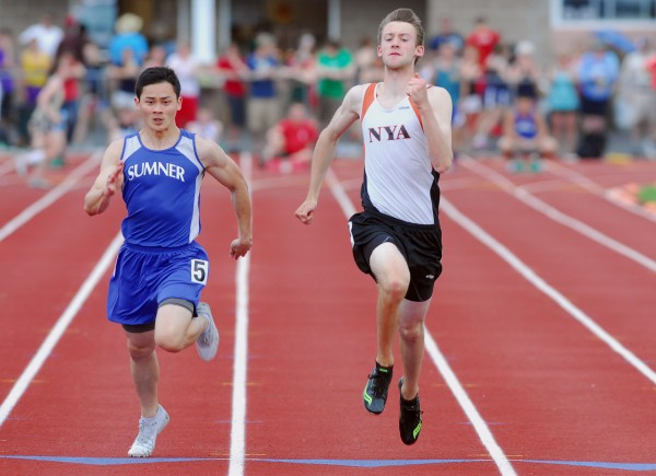 North Yarmouth Academy's Michael McIntosh (right)finishes first in the 100-meter dash with a time of 11.39 seconds just ahead of Sumner'as Baramee Janla's 11.43 during the Class C state track and field championships Saturday at Foxcroft Academy.