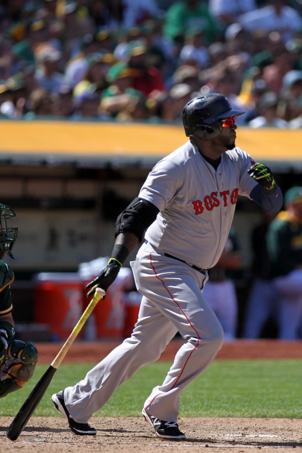 Boston DH David Ortiz hits a game-winning solo home run in the 10th inning against the Oakland Athletics at O.co Coliseum Sunday in Oakland. Boston won 7-6