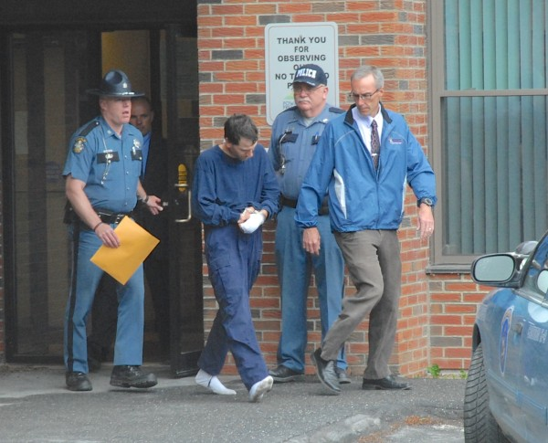 Jesse Marquis is led from the Fort Kent Police Station on Friday afternoon on his way to the Aroostook County Jail in Houlton. Marquis was captured in St. Francis Friday morning after being on the run since Saturday. He was wanted in connection with the shooting death of Amy Theriault last Saturday. Marquis was captured in the woods about a mile from the crime scene Friday morning.