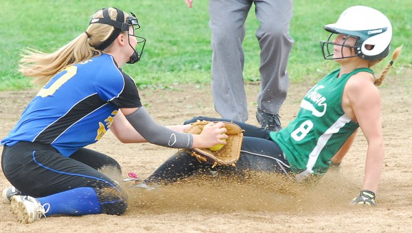 Old Town High School's Karah Hussey is tagged out by Hermon High School's Allessa Oakes after attempting to steal second during the Eastern Maine Class B semifinal softball game Saturday afternoon at Old Town. Hermon won 6-4.