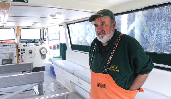 Capt. John Nicolai aboard his boat Lulu, which offers trips out of Bar Harbor, talks Thursday about how they started catering to tourists from China and Japan several years ago.