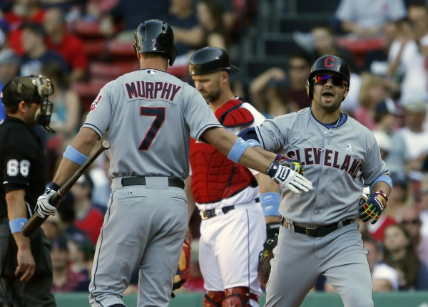 Cleveland's Nick Swisher (33) reacts with teammate David Murphy (7) after hitting a go-ahead home run against the Boston Red Sox in the 11th inning at Fenway Park in Boston Sunday.