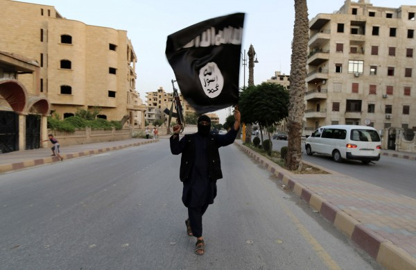 A member loyal to the Islamic State in Iraq and the Levant waves an ISIL flag in Raqqa June 29, 2014. The offshoot of al-Qaida declared itself an Islamic State, or &quotCaliphate,&quot and called on factions worldwide to pledge their allegiance, a statement posted on jihadist websites said Sunday.