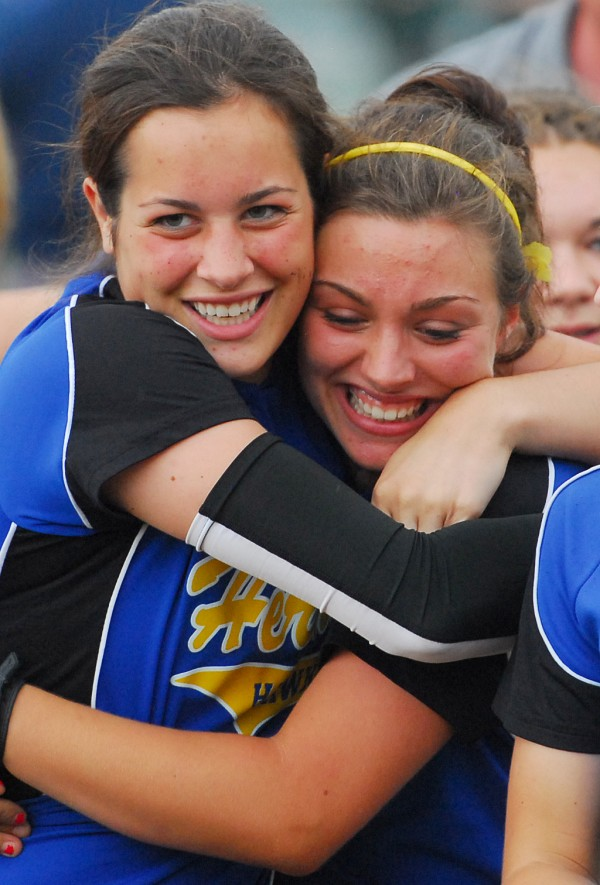 Hermon High School's Emily Perley (left) and Hailey Perry celebrate after winning the Eastern Maine Class B semifinal softball game 6-4 against Old Town High School on Saturday afternoon at Old Town.