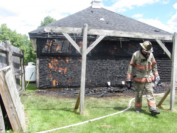Thomaston Assistant Fire Chief Jamie Leo inspects damage done from a Friday fire.