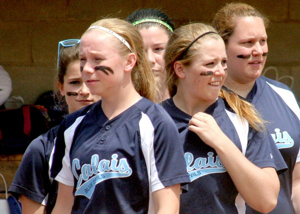 Calais players return to their dugout after shaking hands following the Class C state softball championship game against Madison at St. Joseph's College in Standish on Saturday. Madison won, 1-0.
