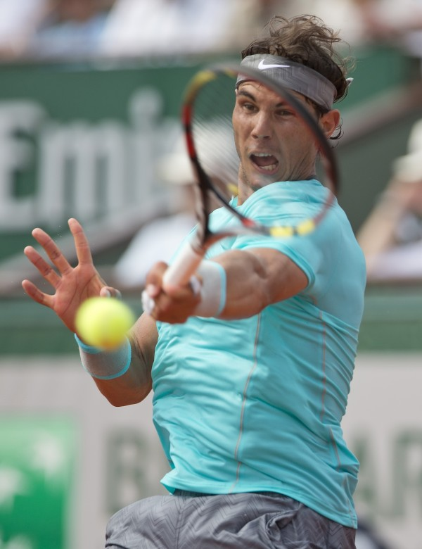 Rafael Nadal returns a shot to Novak Djokovic during their French Open final at Roland Garros in Paris Sunday .