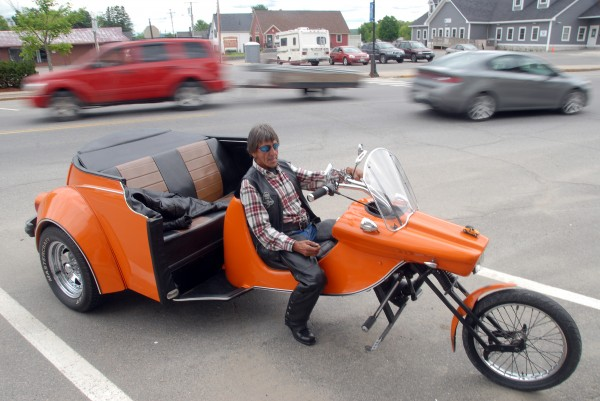 Keith Wilbur, 67, of Fairfield mated a 1974 Volkswagen Beetle to the front end of a fiberglass trike kit to make for a really unique set of wheels he shows off Saturday on Main Street in Lincoln.