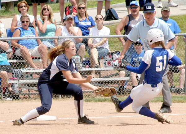 Madison runner Aly LeBlanc (51) slides into third base as Calais third baseman Jasmine Ross applies the tag during the Class C state softball championship game at St. Joseph's College in Standish on Saturday. LeBlanc was out on the play. Madison won, 1-0.
