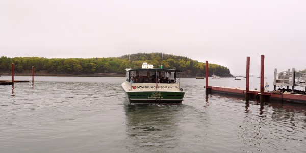 The Lulu a lobster fishing and seal watching tour boat leaves the dock in Bar Harbor.