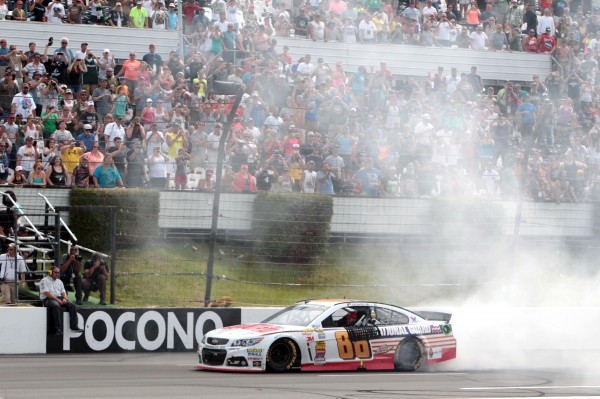 NASCAR Sprint Cup driver Dale Earnhardt Jr (88) celebrates after winning the Pocono 400 at Pocono Raceway Sunday.