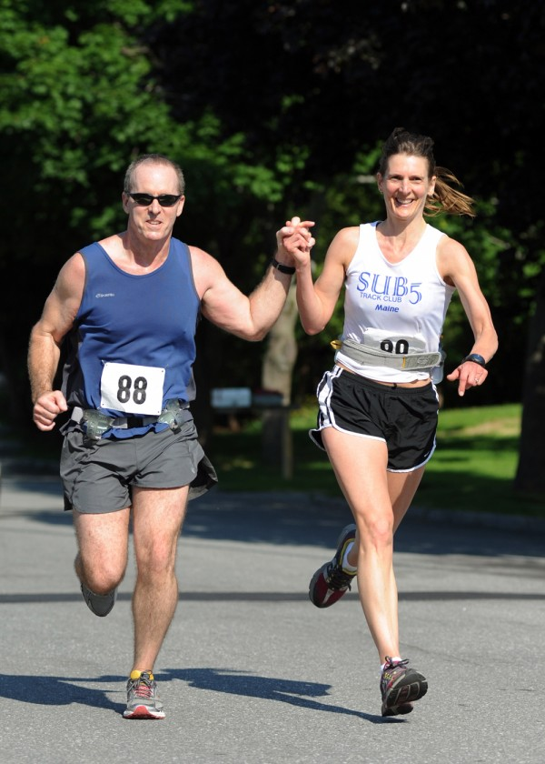 John and Patricia Craig of Dedham hold hands as they come to the finish line of the 39th annual Tour du Lac road race in Bucksport on Saturday.  The couple ran this 10-mile race together 30 years ago.  They finished Saturday with a time of 1 hour, 20 minutes and 27 seconds, which was 1:18 faster than when they ran it in 1984.