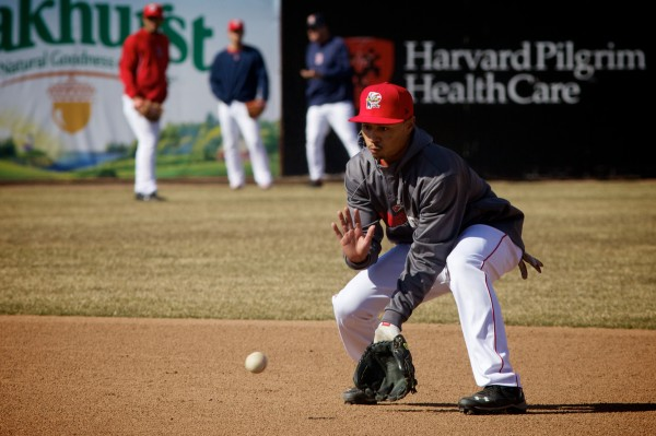 Portland Sea Dogs second baseman Mookie Betts puts his glove down for a ball during batting practice on April 10 at Hadlock Field in Portland. Betts was called up to the Boston Red Sox Saturday for their game in New York against the Yankees.