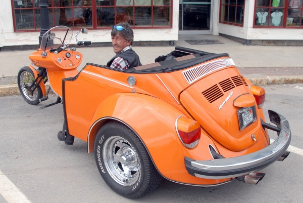 Keith Wilbur of Fairfield shows off his 1974 Volkswagen Beetle mated the front end of a fiberglass trike kit on Saturday in Lincoln.