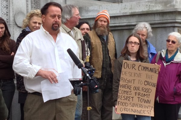Dan Brown, a former dairy farmer from Blue Hill, addresses reporters and supporters before the Maine Supreme Judicial Court heard oral arguments in his appeal against the state on May 13.