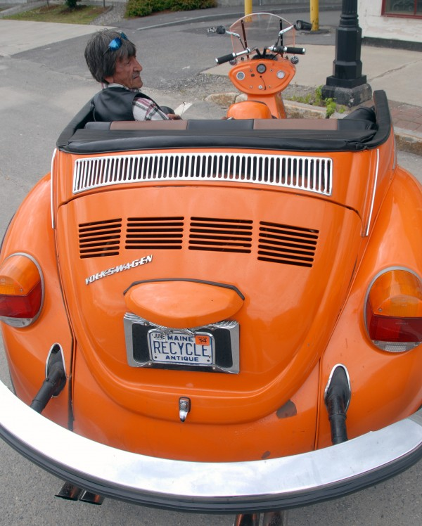 Keith Wilbur of Fairfield, enjoys the back seat of his 1974 Volkswagen Beetle trike Saturday on Main Street in Lincoln.