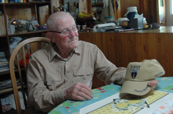 Estol '&quotMac'&quot McClintock of Wellington looks at his hat, which was sent to him by Susan Eisenhower and commemorates the 70th anniversary of D-Day.