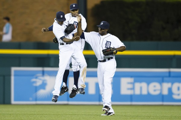 Detroit Tigers center fielder Austin Jackson (left to right) left fielder Rajai Davis (20) and right fielder Torii Hunter (48) celebrate after the game against the Boston Red Sox at Comerica Park in Detroit Saturday night. Detroit won 8-6.