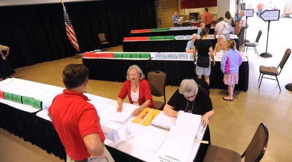People pick up their ballots before they vote at the Cross Insurance Center in Bangor Tuesday morning.