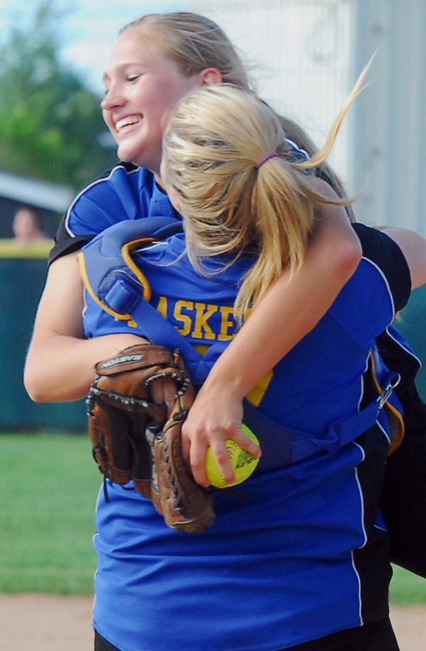 Hermon High School pitcher Karli Theberge (3) is greeted by catcher Shaniah Haskell after defeating Wells High School in the Class B state softball final at Coffin Field in Brewer Saturday.